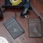 Typhoon navy and brown cardholders on brown wooden table