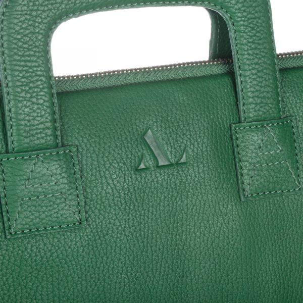 Close up of asali logo on dark green laptop bag