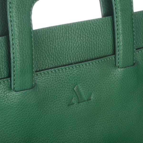 close up of handles on green leather ipad cover