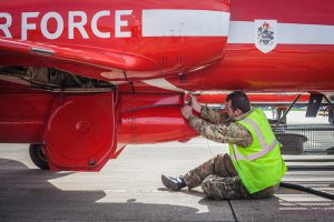 RAF Red Arrows Dye Team attending to a hawk jet
