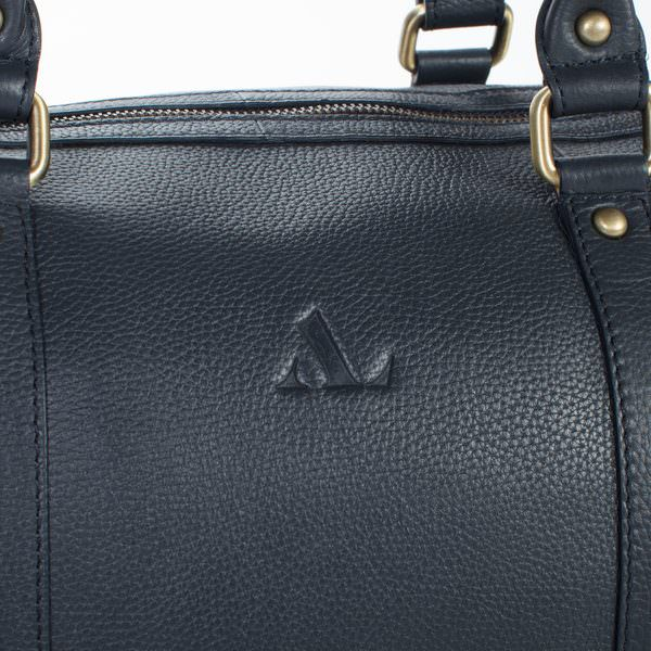 asali logo de-bossed close up on leather weekend bag