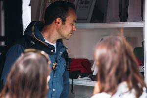 man looking at asali products
