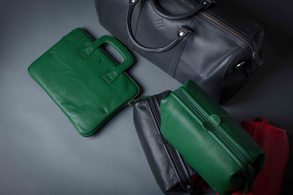 collection of leather goods green, grey, black