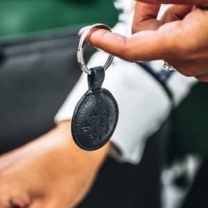 blue leather key ring on finger