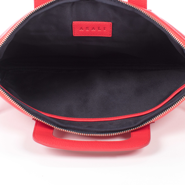 inside of red asali laptop case with black lining