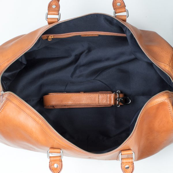 interior of weekend italian leather bag with long strap