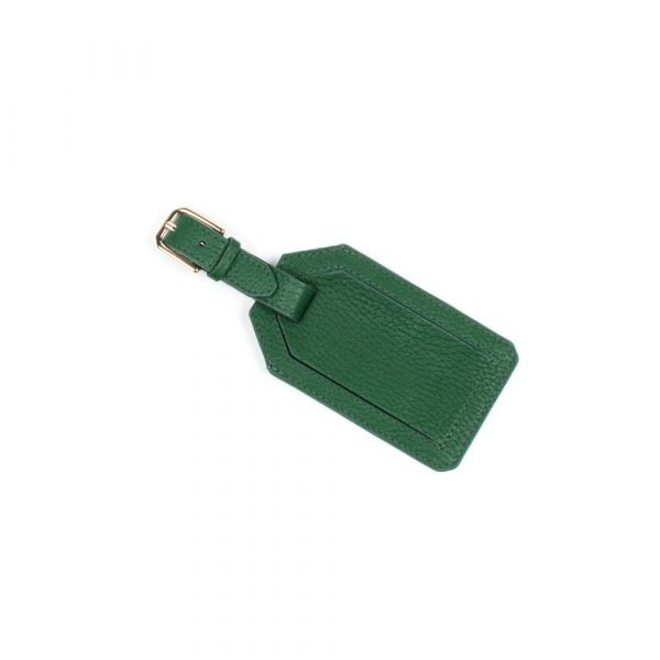 green luggage tag with gold buckle