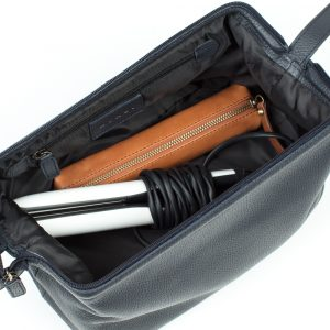 Open wash bag with straighteners and make-upcase