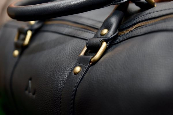 navy leather weekender leather handles on weekend bag close up