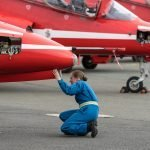 circus red arrows checking before flight