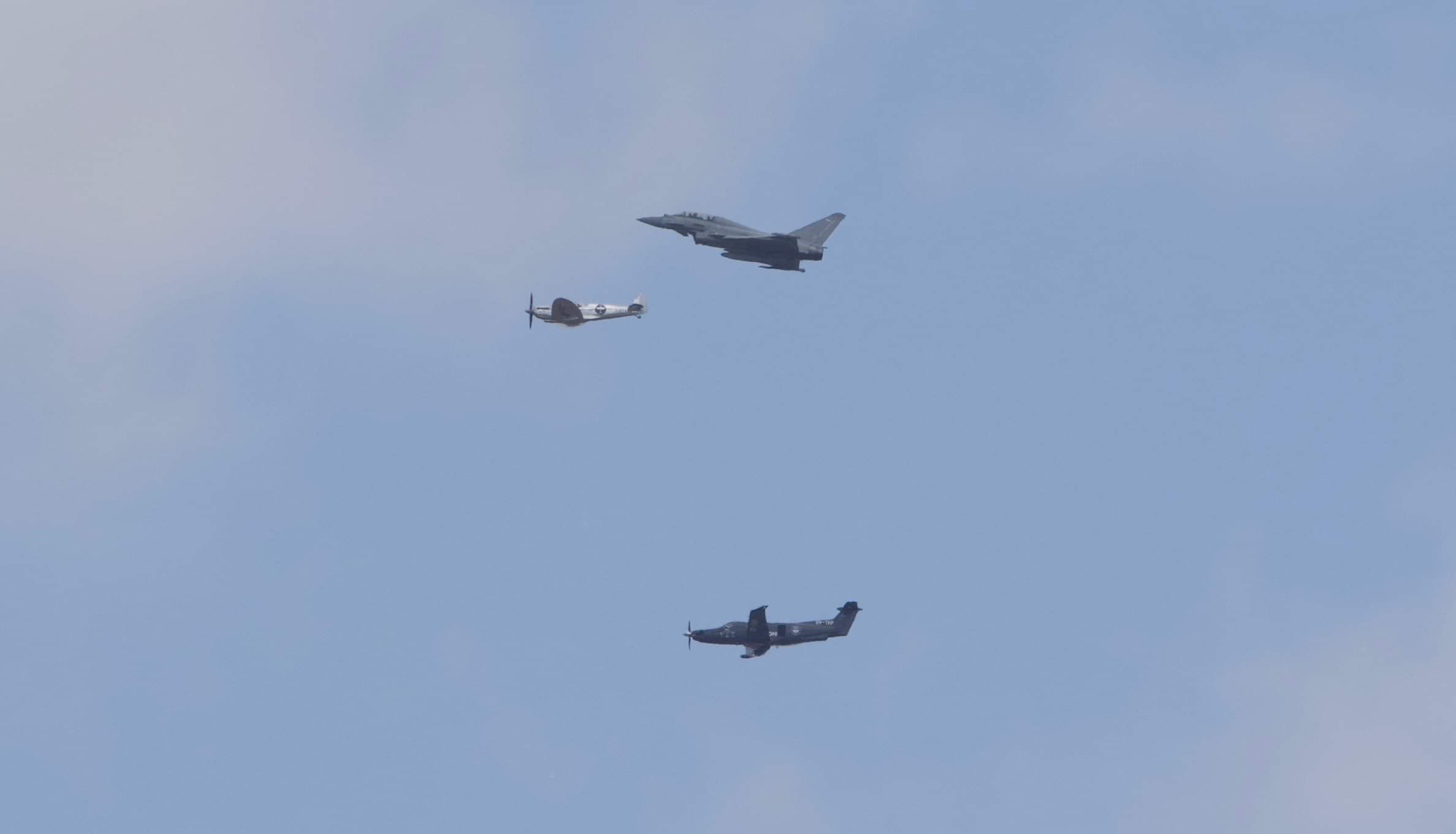 typhoon and silver spitfire over coningsby at the start of the longest flight