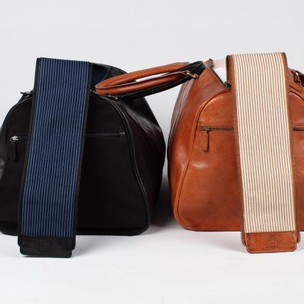 black weekender travel bag next to tan travel bag asali