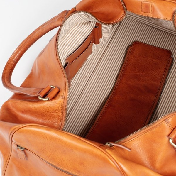 tan leather travel bag with beige lining and internal pockets asali spitfire