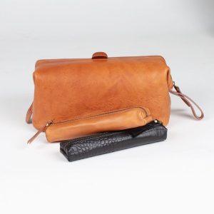 italian tan leather wash bag with tan and croco pencil case asali designs