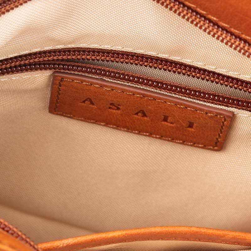 inside of cross body bag zip and cream lining asali designs