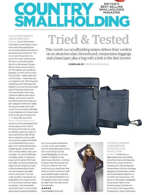 red arrows cross body bag reviewed by small holding magazine